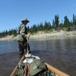 Adam Shoalts pulling Canoe